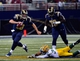 Aug 17, 2013; St. Louis, MO, USA; St. Louis Rams quarterback Kellen Clemens (10) avoids Green Bay Packers cornerback Micah Hyde (33) at the Edward Jones Dome during the second half. The Packers defeated the Rams 19-7. Mandatory Credit: Scott Rovak-USA TODAY Sports