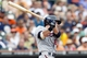 Aug 22, 2013; Detroit, MI, USA; Minnesota Twins catcher Chris Herrmann (12) hits an RBI double in the eighth inning against the Detroit Tigers at Comerica Park. Mandatory Credit: Rick Osentoski-USA TODAY Sports