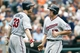 Aug 22, 2013; Detroit, MI, USA; Minnesota Twins short stop Doug Bernier (17) receives congratulations from first baseman Justin Morneau (33) after scoring in the eighth inning against the Detroit Tigers at Comerica Park. Mandatory Credit: Rick Osentoski-USA TODAY Sports