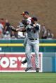 Aug 22, 2013; Detroit, MI, USA; Minnesota Twins center fielder Clete Thomas (11) and right fielder Ryan Doumit (9) celebrate after the game against the Detroit Tigers at Comerica Park. Minnesota won 7-6. Mandatory Credit: Rick Osentoski-USA TODAY Sports