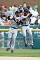Aug 22, 2013; Detroit, MI, USA; Minnesota Twins left fielder Wilkin Ramirez (22) and right fielder Ryan Doumit (9) celebrate after the game against the Detroit Tigers at Comerica Park. Minnesota won 7-6. Mandatory Credit: Rick Osentoski-USA TODAY Sports