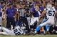 Aug 22, 2013; Baltimore, MD, USA; Baltimore Ravens running back Anthony Allen (35) runs past Carolina Panthers cornerback Josh Thomas (22) at M&T Bank Stadium. Mandatory Credit: Mitch Stringer-USA TODAY Sports