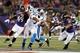 Aug 22, 2013; Baltimore, MD, USA; Carolina Panthers quarterback Cam Newton (1) is rushed from the pocket by Baltimore Ravens linebacker D.J. Bryant (49) and linebacker John Simon (47) at M&T Bank Stadium. Mandatory Credit: Mitch Stringer-USA TODAY Sports