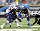 Aug 22, 2013; Detroit, MI, USA; Detroit Lions running back Theo Riddick (41) is tackled by New England Patriots defense during 2nd half at Ford Field. Lions won 40-9.  Mandatory Credit: Mike Carter-USA TODAY Sports