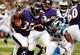 Aug 22, 2013; Baltimore, MD, USA; Baltimore Ravens running back Anthony Allen (35) gives a stiff arm to Carolina Panthers defensive end Frank Alexander (90) at M&T Bank Stadium. Mandatory Credit: Evan Habeeb-USA TODAY Sports