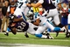 Aug 22, 2013; Baltimore, MD, USA; Baltimore Ravens running back Damien Berry (28) dives for a 10 yard touchdown run in the fourth quarter against the Carolina Panthers at M&T Bank Stadium. Mandatory Credit: Evan Habeeb-USA TODAY Sports