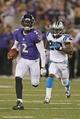 Aug 22, 2013; Baltimore, MD, USA; Baltimore Ravens quarterback Tyrod Taylor (2) runs during the game against the Carolina Panthers cornerback D.J. Moore (20) at M&T Bank Stadium. Mandatory Credit: Mitch Stringer-USA TODAY Sports