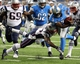 Aug 22, 2013; Detroit, MI, USA; Detroit Lions quarterback Thad Lewis (5) is tackled by New England Patriots defensive end Jake Bequette (92) during 2nd half at Ford Field. Lions won 40-9.  Mandatory Credit: Mike Carter-USA TODAY Sports