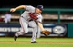 Aug 23, 2013; St. Louis, MO, USA; Atlanta Braves second baseman Elliot Johnson (30) fields a ground ball against the St. Louis Cardinals during the third inning at Busch Stadium. Mandatory Credit: Jeff Curry-USA TODAY Sports