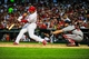 Aug 23, 2013; St. Louis, MO, USA; St. Louis Cardinals center fielder Jon Jay (19) hits a one run double against the Atlanta Braves during the second inning at Busch Stadium. Mandatory Credit: Jeff Curry-USA TODAY Sports