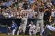 Aug 23, 2013; Kansas City, MO, USA; Washington Nationals players Ryan Zimmerman (11) and Denard Span (2) celebrate after scoring against the Kansas City Royals during the fourth inning at Kauffman Stadium.  Mandatory Credit: Peter G. Aiken-USA TODAY Sports