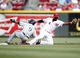 Aug 23, 2013; Cincinnati, OH, USA; Cincinnati Reds second baseman Brandon Phillips (4) misses the tag during the first inning against the Milwaukee Brewers shortstop Jean Segura (9) at Great American Ball Park. Mandatory Credit: Frank Victores-USA TODAY Sports