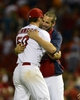 Aug 23, 2013; St. Louis, MO, USA; St. Louis Cardinals starting pitcher Adam Wainwright (50) celebrates with Chris Carpenter after throwing a complete game against the Atlanta Braves at Busch Stadium. St. Louis defeated Atlanta 3-1. Mandatory Credit: Jeff Curry-USA TODAY Sports