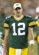 Aug 23, 2013; Green Bay, WI, USA; Green Bay Packers quarterback Aaron Rodgers (12) stands on the sidelines during the fourth quarter against the Seattle Seahawks at Lambeau Field.  Seattle won 17-10.  Mandatory Credit: Jeff Hanisch-USA TODAY Sports