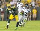 Aug 23, 2013; Green Bay, WI, USA; Seattle Seahawks running back Robert Turbin (22) rushes with the football in front of Green Bay Packers linebacker Donte Savage (94) during the fourth quarter at Lambeau Field.  Seattle won 17-10.  Mandatory Credit: Jeff Hanisch-USA TODAY Sports