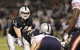 Aug 23, 2013; Oakland, CA, USA; Oakland Raiders quarterback Matthew McGloin (14) prepares for the snap against the Chicago Bears during the fourth quarter at O.co Coliseum. The Chicago Bears defeated the Oakland Raiders 34-26. Mandatory Credit: Kelley L Cox-USA TODAY Sports