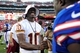 Aug 24, 2013; Landover, MD, USA; Washington Redskins quarterback Robert Griffin III (10) shakes hands with players after the game against the Buffalo Bills at FedEx Field. Mandatory Credit: Evan Habeeb-USA TODAY Sports