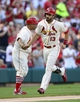 Aug 24, 2013; St. Louis, MO, USA; St. Louis Cardinals third baseman Matt Carpenter (13) is congratulated by third base coach Jose Oquendo (11) after hitting a solo home run off of Atlanta Braves starting pitcher Julio Teheran (not pictured) during the first inning at Busch Stadium. Mandatory Credit: Jeff Curry-USA TODAY Sports