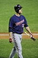 Aug 24, 2013; Cleveland, OH, USA; Minnesota Twins first baseman Justin Morneau (33) walks back to the dugout after striking out in the eighth inning against the Cleveland Indians at Progressive Field. Mandatory Credit: David Richard-USA TODAY Sports
