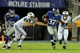 Aug 24, 2013; East Rutherford, NJ, USA; New York Giants corner back Charles James (37) runs a kick back past New York Jets punter Robert Malone (3) and running back Kahlil Bell (24) during the fourth quarter of a preseason game at MetLife Stadium. Mandatory Credit: Brad Penner-USA TODAY Sports