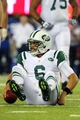 Aug 24, 2013; East Rutherford, NJ, USA; New York Jets quarterback Mark Sanchez (6) reacts after being sacked by New York Giants defensive tackle Marvin Austin (not pictured) during the fourth quarter of a preseason game at MetLife Stadium. Mandatory Credit: Brad Penner-USA TODAY Sports