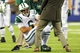 Aug 24, 2013; East Rutherford, NJ, USA; New York Jets quarterback Mark Sanchez (6) is helped off the field after an injury during the fourth quarter of a preseason game against the New York Giants at MetLife Stadium. Mandatory Credit: Brad Penner-USA TODAY Sports