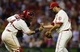 Aug 24, 2013; St. Louis, MO, USA; St. Louis Cardinals relief pitcher Edward Mujica (44) celebrates with catcher Yadier Molina (4) after defeating the Atlanta Braves at Busch Stadium. St. Louis defeated Atlanta 6-2. Mandatory Credit: Jeff Curry-USA TODAY Sports
