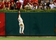 Aug 24, 2013; St. Louis, MO, USA; St. Louis Cardinals center fielder Jon Jay (19) jumps and catches a ball hit by Atlanta Braves catcher Brian McCann (not pictured) during the seventh inning at Busch Stadium. St. Louis defeated Atlanta 6-2. Mandatory Credit: Jeff Curry-USA TODAY Sports