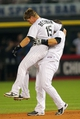 Aug 24, 2013; Chicago, IL, USA; Chicago White Sox catcher Josh Phegley (36) lifts team mate second baseman Gordon Beckham (15) to celebrate hitting a game winning RBI single during the ninth inning against the Texas Rangers at US Cellular Field. Chicago won 3-2. Mandatory Credit: Dennis Wierzbicki-USA TODAY Sports