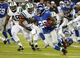 Aug 24, 2013; East Rutherford, NJ, USA; New York Giants running back Michael Cox (29) returns a kick against the New York Jets during the second half at MetLife Stadium. New York Jets defeat the New York Giants 24-21 in OT. Mandatory Credit: Jim O'Connor-USA TODAY Sports