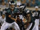 Aug 24, 2013; Jacksonville, FL, USA; Philadelphia Eagles quarterback Nick Foles (9) hands off the ball to running back Bryce Brown (34) during the fourth quarter of their game at EverBank Field. The Philadelphia Eagles beat the Jacksonville Jaguars 31-24. Mandatory Credit: Phil Sears-USA TODAY Sports