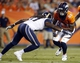 Aug 24, 2013; Denver, CO, USA; Denver Broncos wide receiver Demaryius Thomas (88) runs with the ball after catching a pass during the second half against the St. Louis Rams at Sports Authority Field at Mile High. The Broncos won 27-26.  Mandatory Credit: Chris Humphreys-USA TODAY Sports