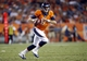 Aug 24, 2013; Denver, CO, USA; Denver Broncos quarterback Brock Osweiler (17) looks to pass the ball during the second half against the St. Louis Rams at Sports Authority Field at Mile High. The Broncos won 27-26.  Mandatory Credit: Chris Humphreys-USA TODAY Sports