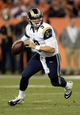 Aug 24, 2013; Denver, CO, USA; St. Louis Rams quarterback Austin Davis (9) rolls out as he prepares to pass during the game against the Denver Broncos at Sports Authority Field .The Broncos defeated the Rams 27-26. Mandatory Credit: Ron Chenoy-USA TODAY Sports
