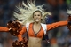 Aug 24, 2013; Denver, CO, USA; Denver Broncos cheerleader performs during the preseason game against the St. Louis Rams at Sports Authority Field .The Broncos defeated the Rams 27-26. Mandatory Credit: Ron Chenoy-USA TODAY Sports