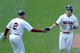 Aug 25, 2013; Cleveland, OH, USA; Cleveland Indians right fielder Drew Stubbs (right) celebrates his solo home with third base coach Brad Mills (2) in the eighth inning against the Minnesota Twins at Progressive Field. Mandatory Credit: David Richard-USA TODAY Sports
