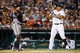 Aug 21, 2013; Detroit, MI, USA; Minnesota Twins right fielder Ryan Doumit (9) signals to intentionally walk Detroit Tigers third baseman Miguel Cabrera (24) at Comerica Park. Mandatory Credit: Rick Osentoski-USA TODAY Sports