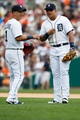 Aug 22, 2013; Detroit, MI, USA; Detroit Tigers third baseman Miguel Cabrera (24) and shortstop Jose Iglesias (1) laugh during the game against the Minnesota Twins at Comerica Park. Mandatory Credit: Rick Osentoski-USA TODAY Sports