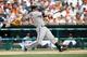 Aug 22, 2013; Detroit, MI, USA; Minnesota Twins second baseman Brian Dozier (2) at bat against the Detroit Tigers at Comerica Park. Mandatory Credit: Rick Osentoski-USA TODAY Sports