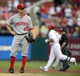 Aug 26, 2013; St. Louis, MO, USA; Cincinnati Reds starting pitcher Mike Leake (44) looks on after giving up a three run home run to St. Louis Cardinals left fielder Matt Holliday (7) during the third inning at Busch Stadium. Mandatory Credit: Jeff Curry-USA TODAY Sports