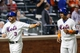 Aug 27, 2013; New York, NY, USA;  New York Mets shortstop Omar Quintanilla (3) and center fielder Juan Lagares (12) head to the dugout after scoring during the sixth inning against the Philadelphia Phillies at Citi Field. Mandatory Credit: Anthony Gruppuso-USA TODAY Sports