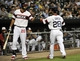 Aug 28, 2013; Chicago, IL, USA; Chicago White Sox second baseman Leury Garcia (28) is greeted by Sox center fielder Jordan Danks (20) after scoring against the Houston Astros during the first inning at U.S. Cellular Field.  Mandatory Credit: David Banks-USA TODAY Sports