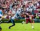 Aug 29, 2013; Columbia, SC, USA; South Carolina Gamecocks quarterback Connor Shaw (14) passes as he is pressured by North Carolina Tar Heels defensive end Kareem Martin (95) in the second quarter at Williams-Brice Stadium. Mandatory Credit: Jeff Blake-USA TODAY Sports