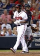 Aug 29, 2013; Atlanta, GA, USA; Atlanta Braves left fielder Justin Upton (8) reacts after he is hit by a pitch against the Cleveland Indians in the fifth inning at Turner Field. Mandatory Credit: Brett Davis-USA TODAY Sports