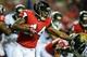 Aug 29, 2013; Atlanta, GA, USA; Atlanta Falcons fullback Jason Snelling (44) stiff arms Jacksonville Jaguars outside linebacker Julian Stanford (57) in the second quarter at the Georgia Dome. Mandatory Credit: Daniel Shirey-USA TODAY Sports