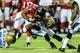Aug 29, 2013; Atlanta, GA, USA; Jacksonville Jaguars free safety Josh Evans (26) tackles Atlanta Falcons running back Jacquizz Rodgers (32) on a run in the second quarter at the Georgia Dome. Mandatory Credit: Daniel Shirey-USA TODAY Sports
