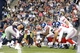 Aug 29, 2013; Foxborough, MA, USA; New York Giants quarterback Eli Manning (10) at the line of scrimmage against the New England Patriots in the first quarter at Gillette Stadium. Mandatory Credit: David Butler II-USA TODAY Sports