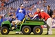 Aug 29, 2013; Orchard Park, NY, USA; Buffalo Bills center Doug Legursky (59) gets taken off the field after a injury in the second half of a game against the Detroit Lions at Ralph Wilson Stadium.  The Lions won 35-13.   Mandatory Credit: Timothy T. Ludwig-USA TODAY Sports