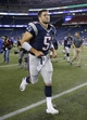 Aug 29, 2013; Foxborough, MA, USA; New England Patriots quarterback Tim Tebow (5) exits the field after the game against the New York Giants at Gillette Stadium. The Patriots defeated the Giants 28-20. Mandatory Credit: David Butler II-USA TODAY Sports