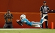 Aug 29, 2013; Miami Gardens, FL, USA; Miami Dolphins defensive back De'Andre Presley (23) intercepts a pass against the New Orleans Saints in the fourth quarter at Sun Life Stadium. The Dolphins won 24-21. Mandatory Credit: Robert Mayer-USA TODAY Sports